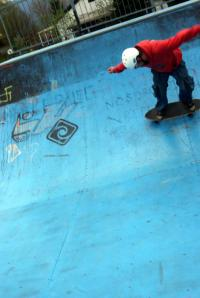 Carver Skateboarding On Half-pipe Ramp