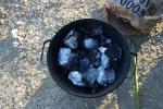 Put Potatos Into Hot Charkcoal
