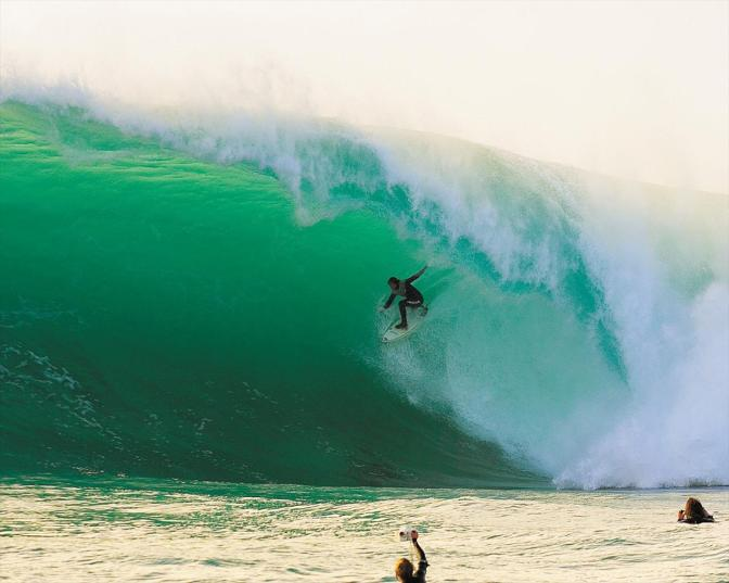 Surfer in a giant wave